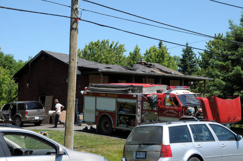 A person heads into the site Saturday, June 18, 2016 after an overnight fire at the home on Tyotown Road, east of Cornwall. The fire department says it managed to save a number of the family's possessions and valuables. (Newswatch Group/Bill Kingston)