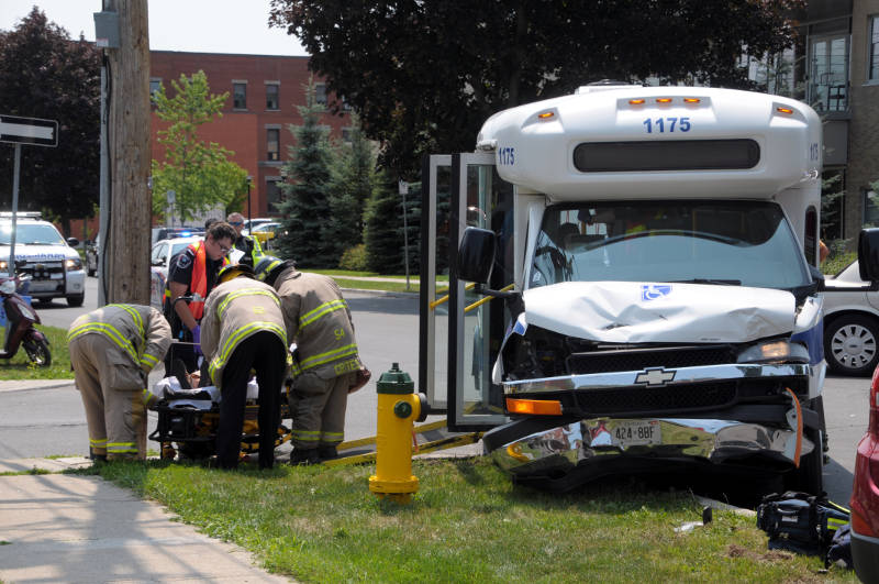An occupant of the Cornwall Transit bus is placed on a stretcher Wednesday, July 20, 2016 after a crash between the bus and an SUV. Seven people were assessed at Cornwall Community Hospital. (Newswatch Group/Bill Kingston)