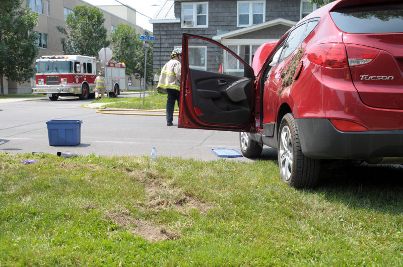 Large clumps of dirt are wedged in the back door of an SUV Wednesday, July, 20, 2016 after the truck flipped during a collision at the intersection of First and York Streets in Cornwall, Ont. Seven people -- two in the SUV and five in a Cornwall Transit bus -- were taken to hospital as a precaution. (Newswatch Group/Bill Kingston)
