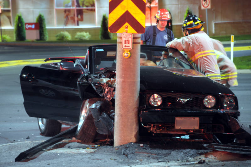 Cornwall firefighters use the Jaws of Life Monday, Aug. 29, 2016 to free a driver of a Ford Mustang after a two vehicle crash at Brookdale Avenue and Thirteenth Street. (Newswatch Group/Bill Kingston)