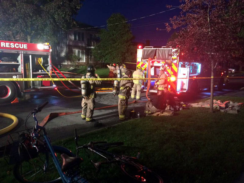 In this Wednesday, Aug. 31, 2016 photo supplied by Keelan O'Flaherty, firefighters assemble on Gardner Avenue where a fire in a two-storey home destroyed the structure. There are no reported injuries. (Keelan O'Flaherty via Newswatch Group)