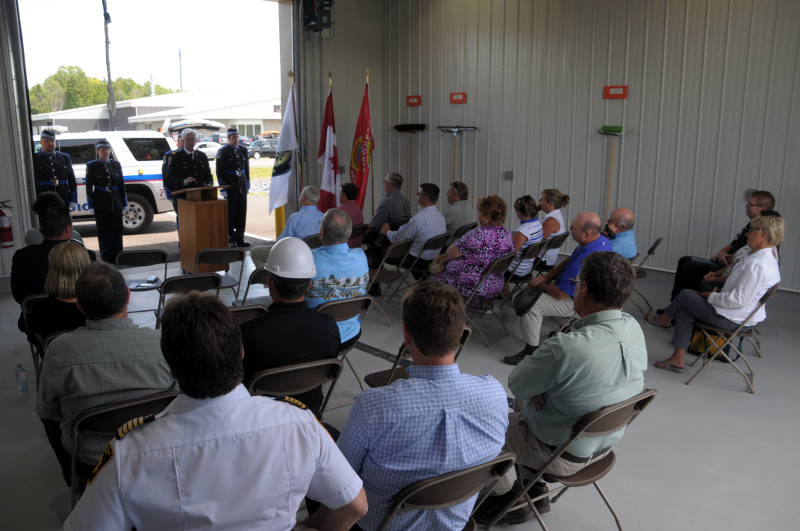 Cornwall SDG Paramedic Service Chief Myles Cassidy speaks to the audience Tuesday, Aug. 9, 2016 during the official opening of the ambulance base in Long Sault, Ont. The base on Moulinette Road will have a paramedic response unit (background) stationed on a 12-hour shift. (Newswatch Group/Bill Kingston)