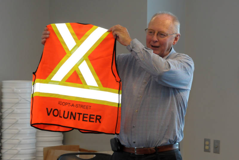 Cornwall Parks Supervisor Jim Althouse shows off the new Adopt-A-Street volunteer vests on Wednesday, Oct. 19, 2016 during a recognition event at the Benson Center in Cornwall Ont. The program, where volunteers clean up streets in their neighbourhood, has been officially running for just over a year. (Newswatch Group/Bill Kingston)