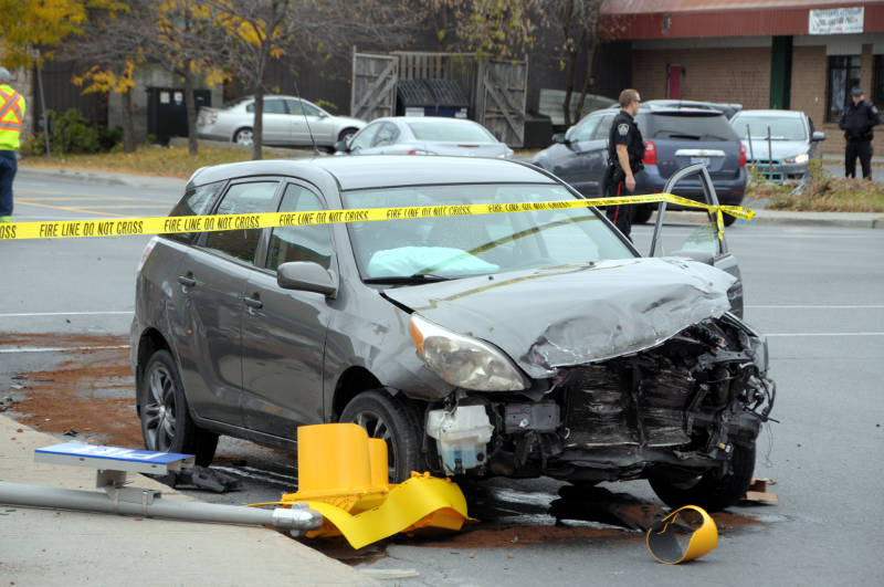 A Toyota Matrix has extensive front-end damage after a collision at Pitt and Ninth Streets on Wednesday, Oct. 26, 2016. No one was hurt in the crash, which took down a traffic light standard. (Newswatch Group/Bill Kingston)