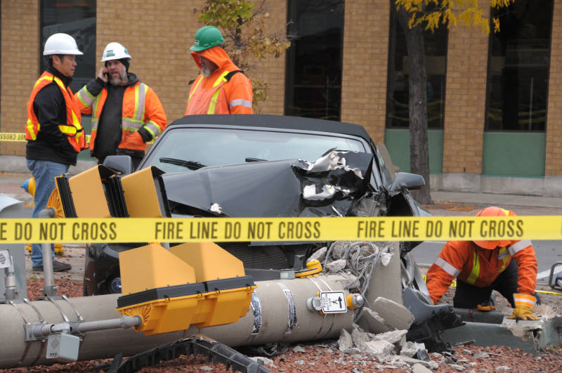The remains of a Chevrolet Camaro sit beside a sheared off light standard at the intersection of Ninth and Pitt Streets in Cornwall, Ont. on Wednesday, Oct. 26, 2016. Police say no one was hurt. (Newswatch Group/Bill Kingston)