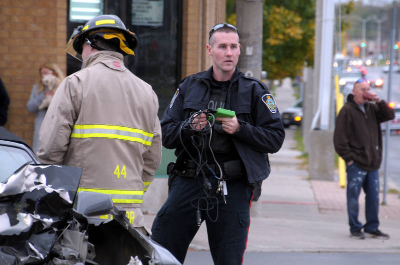 Cornwall Community Police Service Const. Matt Dupuis finishes uploading the data from the on board computer in a Chevrolet Camaro, involved in a two vehicle crash. The collision on Wednesday, Oct. 26, 2016 destroyed the Camaro and a Toyota Matrix but everyone walked away unhurt. (Newswatch Group/Bill Kingston)