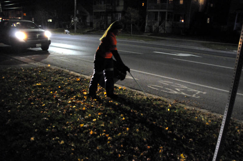 Cornwall Parks and Landscaping employee Amber DeVries picks up trash along Second Street West on Saturday, Nov. 19, 2016 following the Santa Claus Parade. The city had 100 bins out along the route for people to get rid of their litter. (Newswatch Group/Bill Kingston)