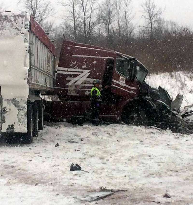 In this Saturday, Dec. 17, 2016 photo taken by Philippe Boyer Vazina, three tractor-trailers collided on a section of Highway 401, east of Cornwall, Ont. There are no reported injuries. (Philippe Boyer Vezina/Facebook via Newswatch Group)